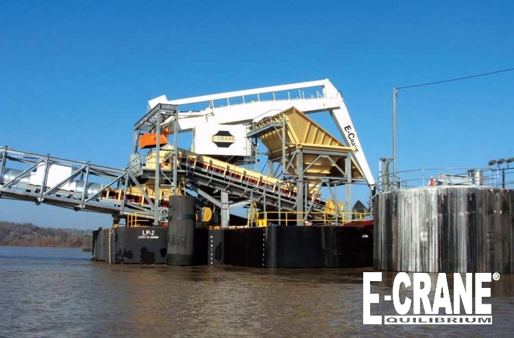 The floating terminal includes two barges: one for the E-Crane (shown here) and one to support the conveyor. Maximum  outreach of the E-Crane is 86.5 ft from center of rotation. Boom length is 52.5 ft. Stick length is 38 ft.