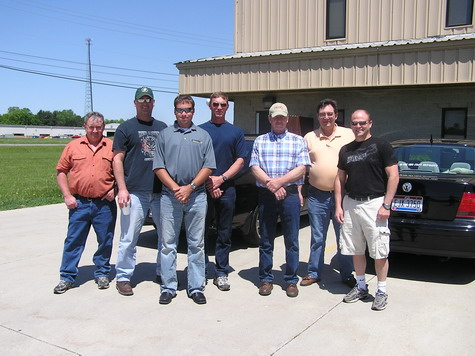 Shawn Nuzum, Ralph Beerbower, Doug Born, Tony Altieri, Rick Michael and Mike Kridle with E-Crane engineer Steve Osborne (third from left).