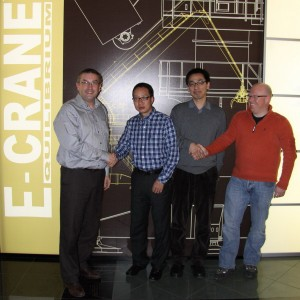 E-Crane's Mr. Bauwens and Mr. Tolhuizen shaking hands with Mr. Zeng and Mr. Lee from Bulktech Solution Engineering Service Co., Ltd, China.