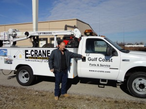 Bill McNair in front of his duty service truck