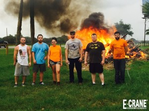 The E-Crane Texas Service Center crew worked hard last week laying stone around the building to give it a new, updated look.  They celebrated by having a bonfire with the old materials and cooking out with the new team.  You know what they say...everything is bigger in Texas!