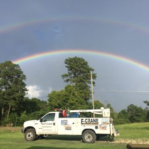 Recently, our gulf coast service manager, Bill McNair took this unique photo while working in Alabama, USA.  The picture shows a double rainbow over the E-Crane service truck.